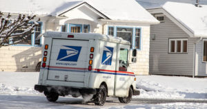 holiday package USPS truck in snow feature
