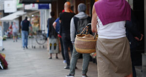 shoppers on retail queue covid-19